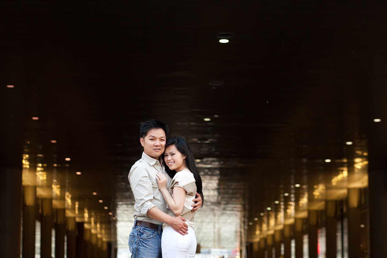vietnamese couple posing for a portrait downtown